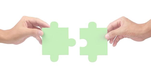 Mão de conectar quebra-cabeça isolada