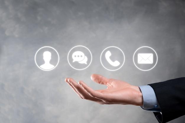 Mão de empresário segurando, pressionando o ícone de telefone, correio, telefone, mensagem, postagem e pessoa, usuário. centro de atendimento ao cliente entre em contato conosco concept.banner, copie o espaço.métodos de contato.