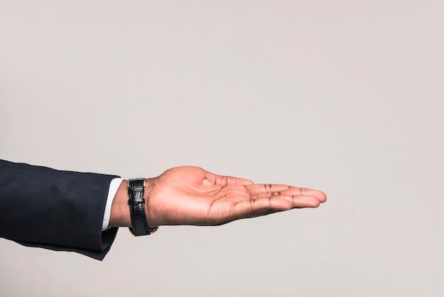 Mão de homem de negócios étnico
