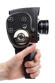 Mão de homem segurando uma câmera de filme vintage