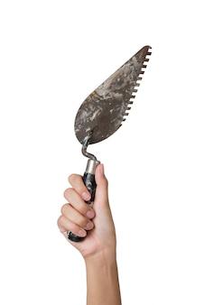 Mão de mulher de trabalhador segurando espátula isolada no branco