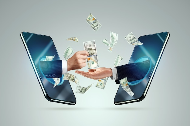 Mão de um smartphone transfere dinheiro para outra mão.