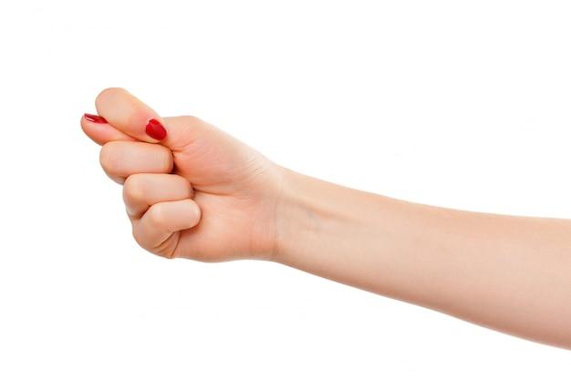 Mão de uma mulher com gesto de punho isolado no branco