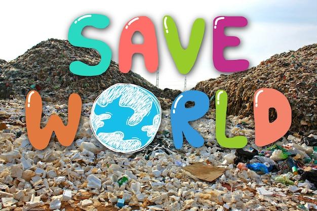 Mão desenhando save world no depósito de lixo no fundo do aterro. conceito de conservação do meio ambiente