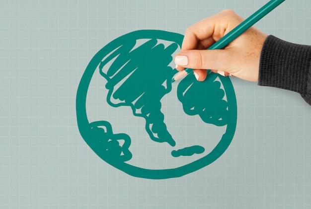 Mão, desenho, um, globo verde, ligado, um papel