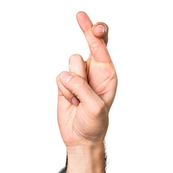 Mão do homem com os dedos cruzando