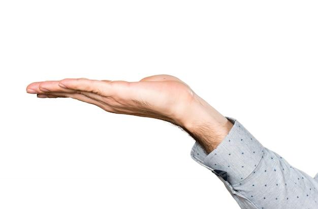 Mão do homem segurando algo