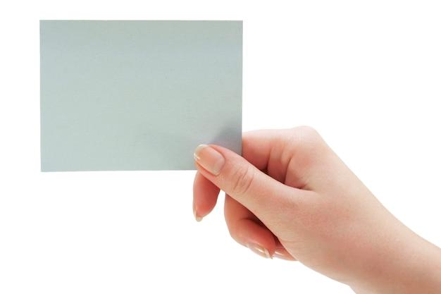 Mão e adesivo em uma mesa branca. isolado no branco.