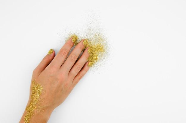 Mão e glitter com espaço de cópia