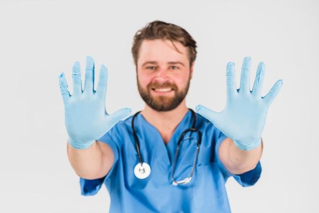 Mão, em, azul, luvas, de, enfermeira, macho