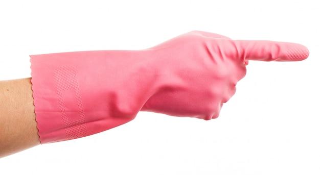 Mão em uma luva doméstica rosa mostra
