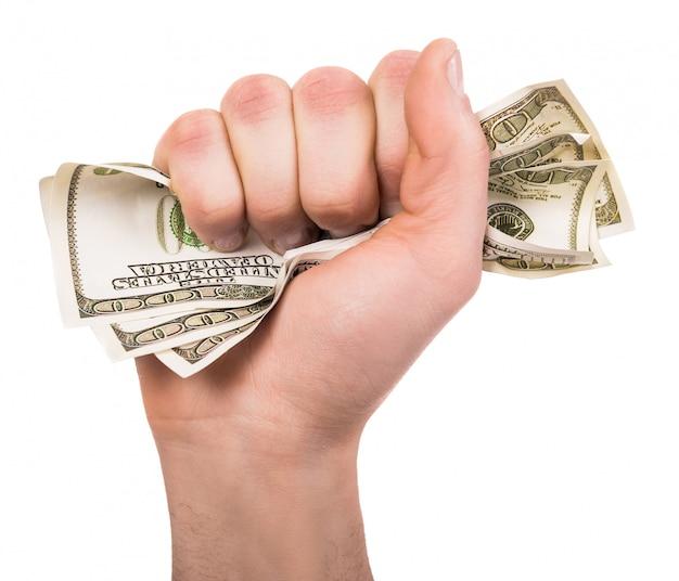 Mão enrugar um monte de notas de dólar isolado.