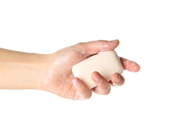 Mão feminina com sabonete e espuma isolada no fundo branco