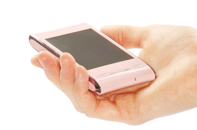 Mão feminina segurando um telefone moderno com tela de toque