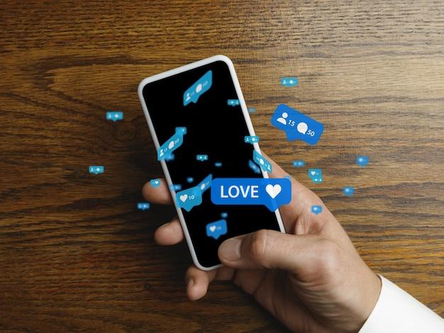 Mão masculina que desliza o telefone e compartilha com as redes sociais, usando o gadget. obtenha comentários, gostos. ícones modernos da interface do usuário, comunicação, dispositivos. conceito de tecnologias modernas, redes, gadgets. projeto.