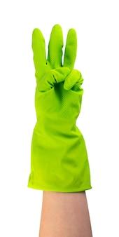 Mão na luva protetora de borracha verde isolada. mão enluvada levantada com três dedos