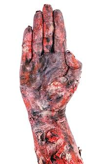 Mão no gesto de parada, sinal de perigo, mão realista de zumbi, superfície branca.