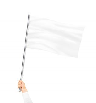Mão segurando a bandeira branca em branco simulado