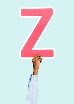 Mão segurando a letra z