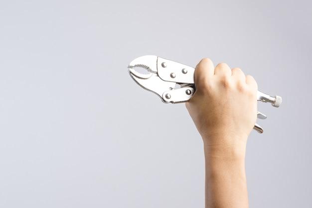 Mão, segurando, alicates, ou, apertos mole