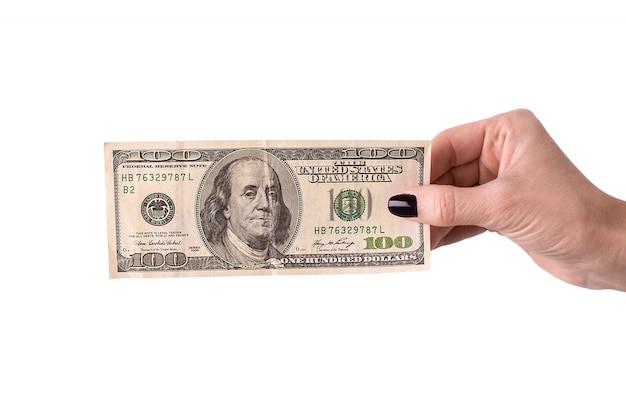 Mão segurando dinheiro dólares