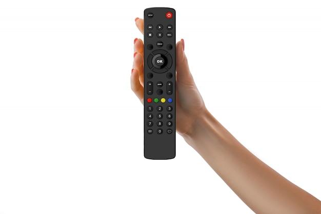 Mão segurando o controle remoto universal isolado no branco