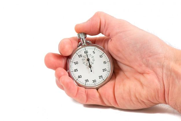 Mão segurando o cronômetro em branco backgrpund
