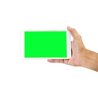 Mão segurando o telefone inteligente com tela verde isolada