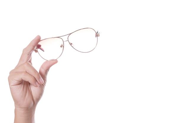 Mão segurando óculos vintage