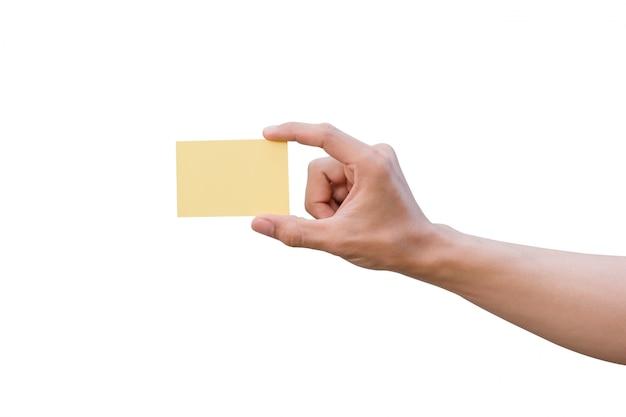Mão segurando papel amarelo isolado no branco