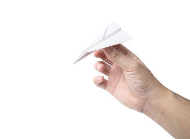 Mão segurando um avião de papel isolado no branco