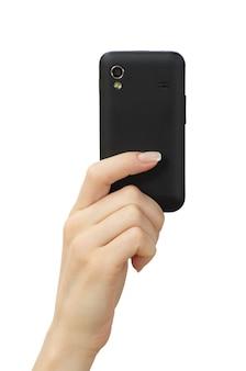 Mão segurando um celular inteligente com tela em branco