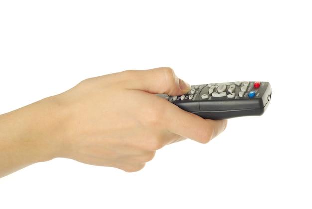 Mão segurando um controle remoto isolado sobre um fundo branco