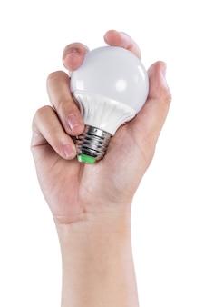 Mão segurando uma lâmpada lught