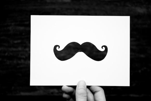 Mão, segurar, bigode, papel, esculpindo
