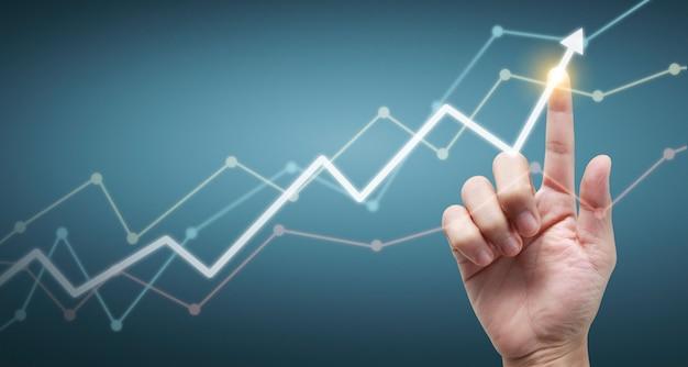 Mão tocando gráficos do indicador financeiro e gráfico de análise de economia de mercado contábil