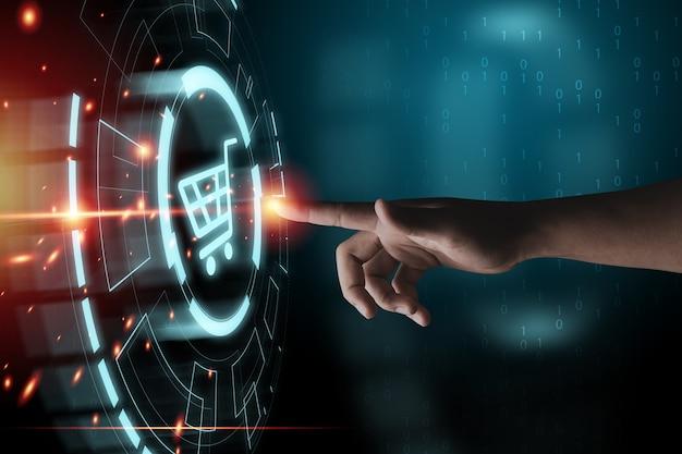 Mão tocando para gráficos de informação virtual com ícones de carrinho de carrinho, conceito de negócio de compras on-line de tecnologia.