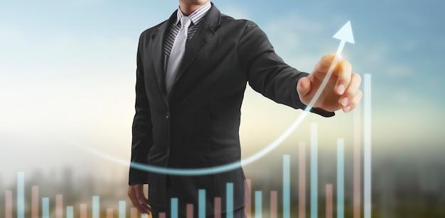 Mão tocando um gráfico de indicador financeiro e gráfico de análise de economia de mercado contábil