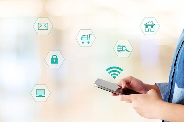 Mão, usando, smartphone, internet, coisas, ícone, borrado, fundo