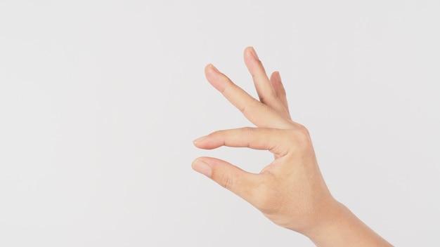 Mão vazia e dedo segurando o gesto sobre fundo branco.