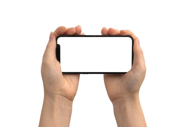 Mãos com maquete de telefone em branco na tela horizontal, copie a foto do espaço