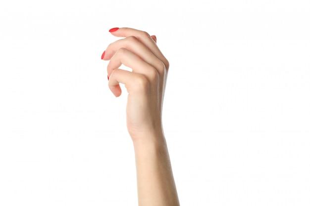 Mãos da mulher, manicure vermelho à moda isolado no fundo branco, close up. conceito de saúde