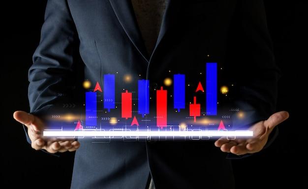 Mãos do empresário com finanças bancárias do mercado de ações no gráfico de velas em um fundo preto