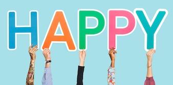 Mãos segurando a palavra feliz
