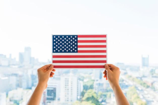 Mãos, segurando, bandeira, de, américa
