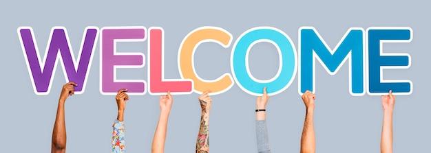 Mãos, segurando, palavra, bem-vindo