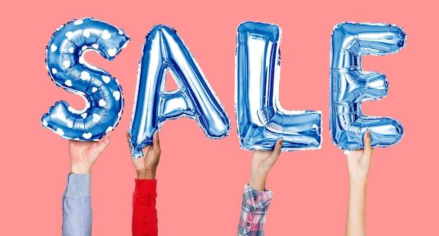 Mãos, segurando, venda, palavra, em, balloon, letras