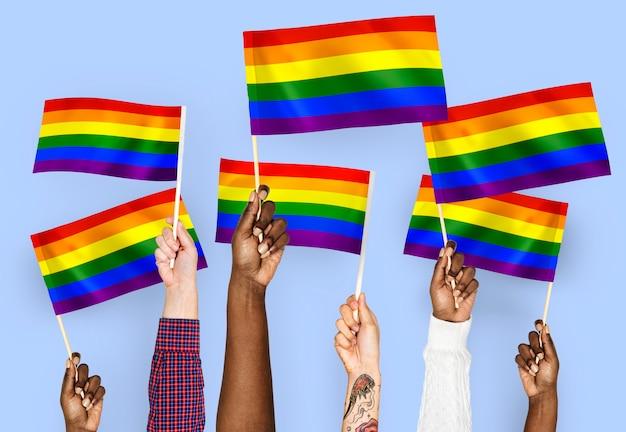 Mãos, waving, arco íris, bandeiras