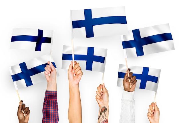 Mãos, waving, bandeiras, de, finland