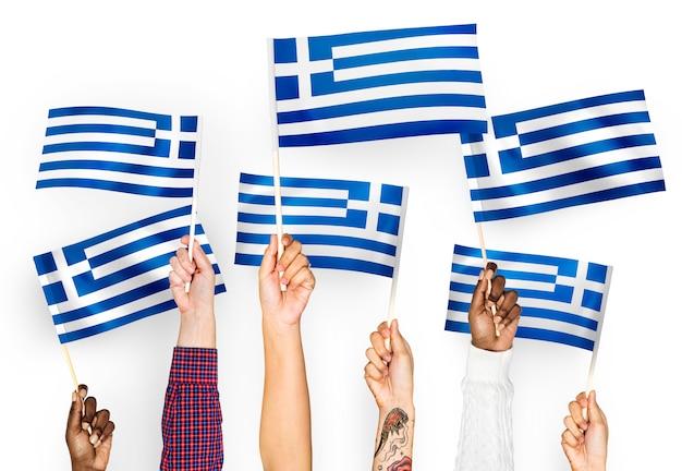Mãos, waving, bandeiras, de, grécia
